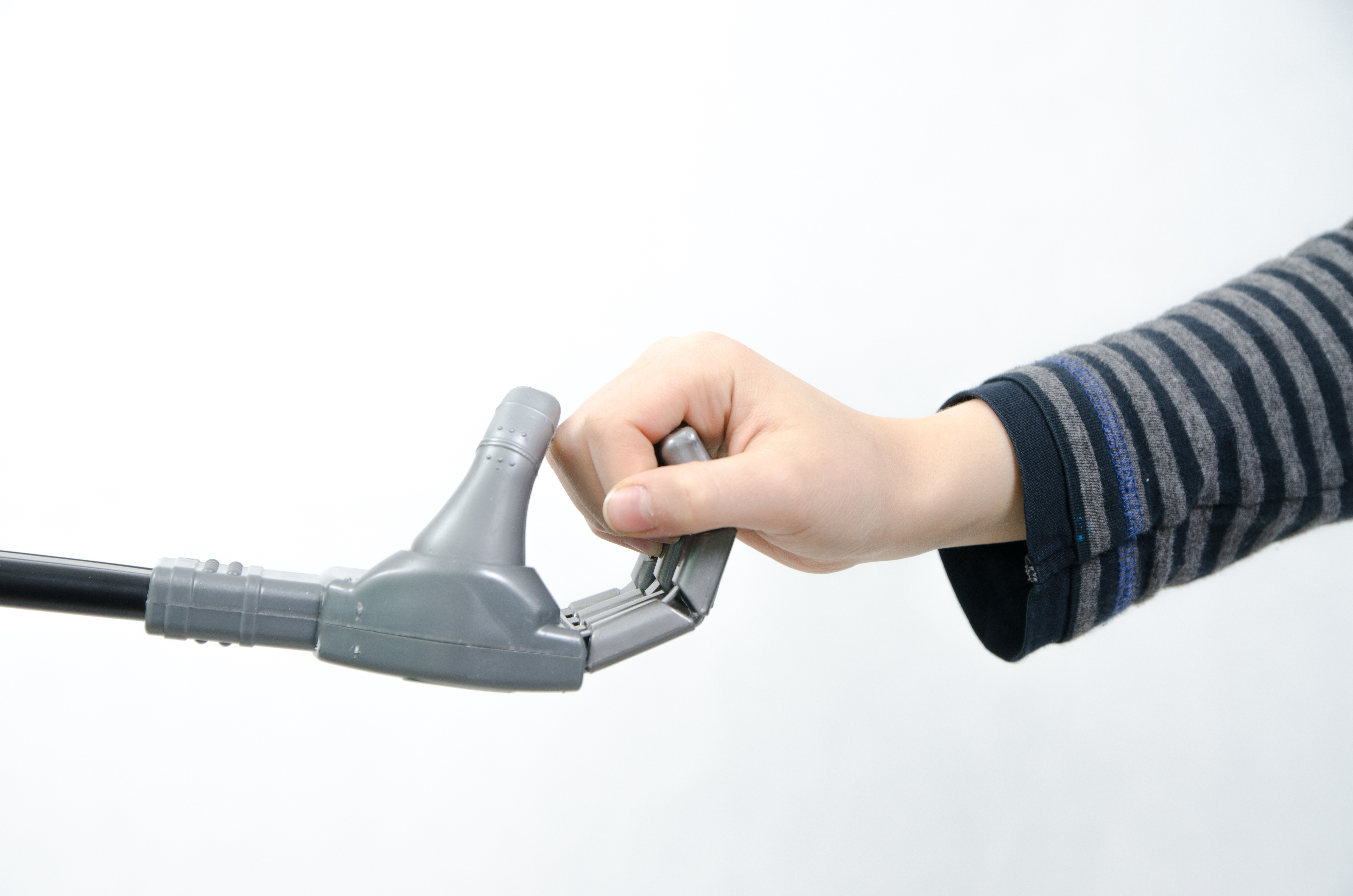 Close up on a boy's hand holding robot's fingers